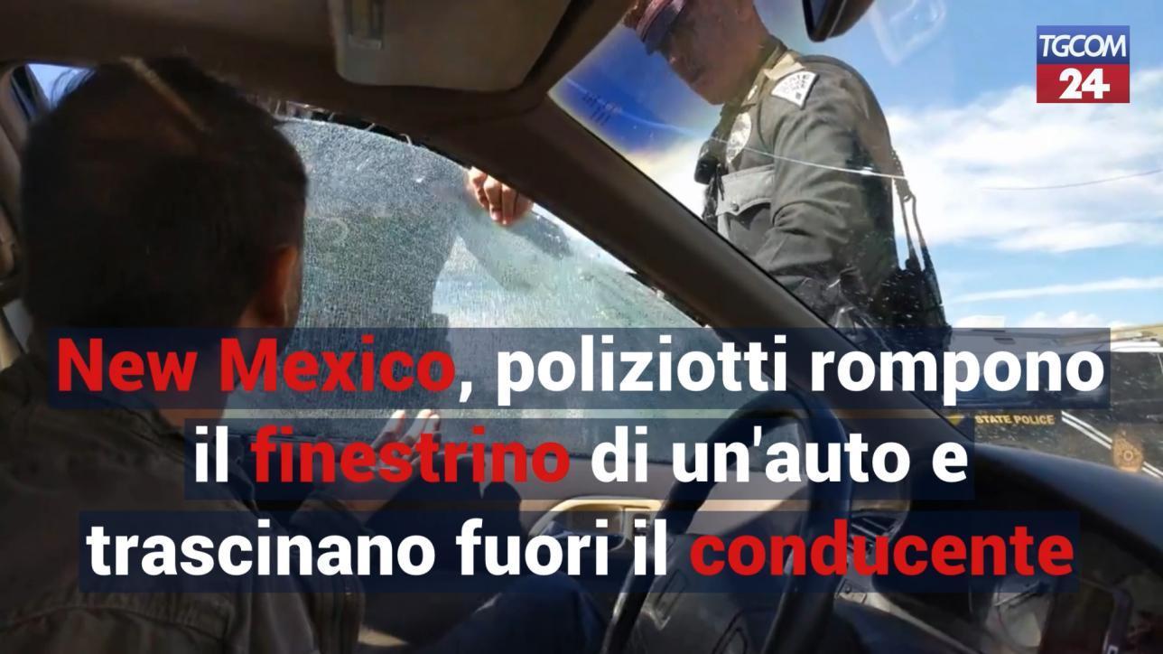 new mexico, si rifiuta di fornire generalità e di sbloccare la portiera. poliziotti rompono il vetro dell`auto