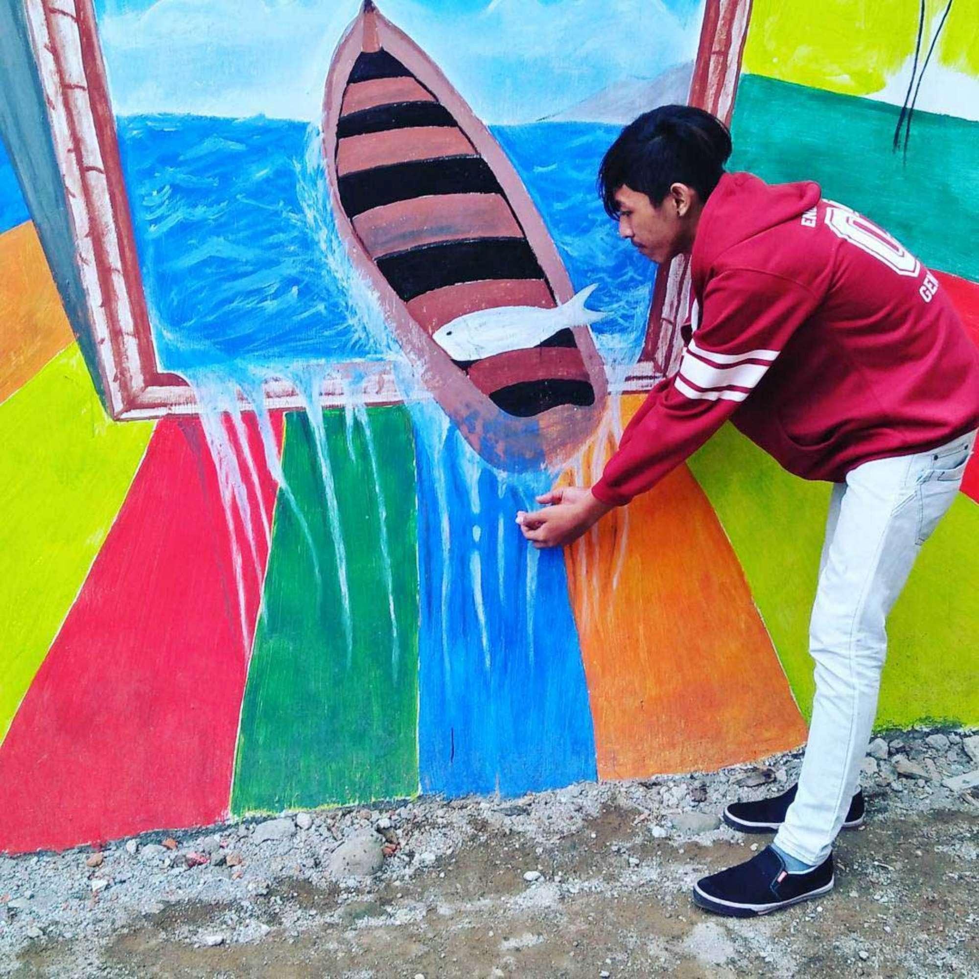 Indonesia, un arcobaleno di colori ridipinge la baraccopoli